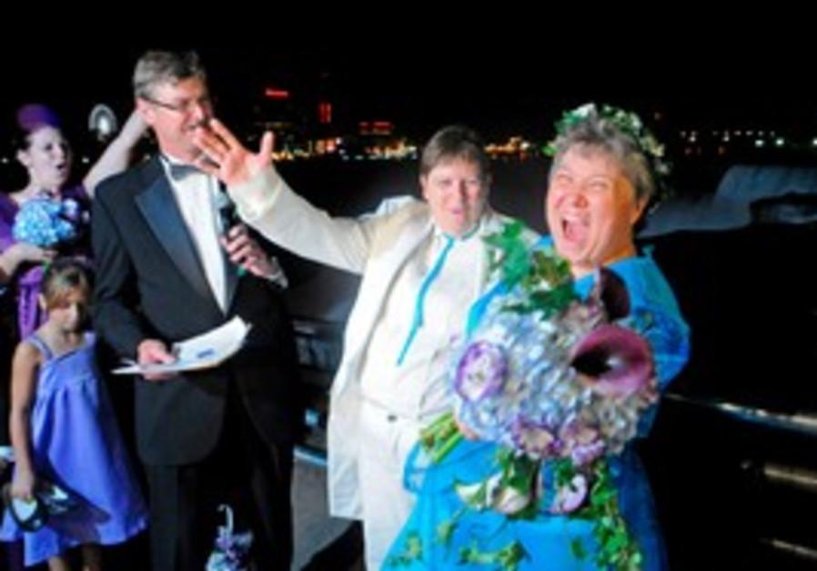 Rudd and Lambert (R) after their wedding.