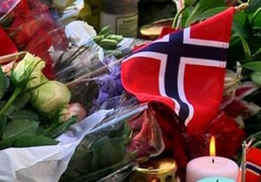 People light candles for Norway attack victims.