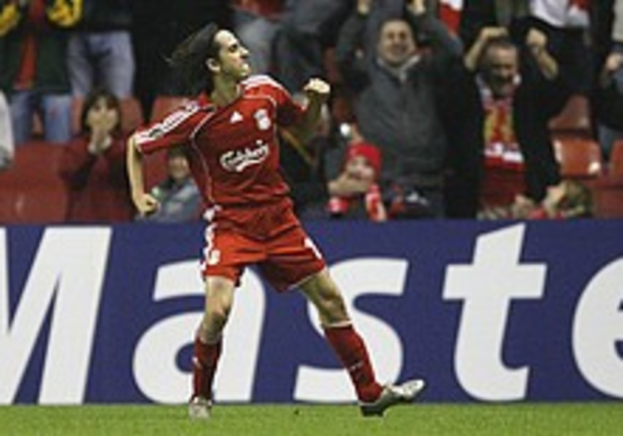 English Soccer: Benayoun scores 2 but Arshavin dents Liverpool's title hopes