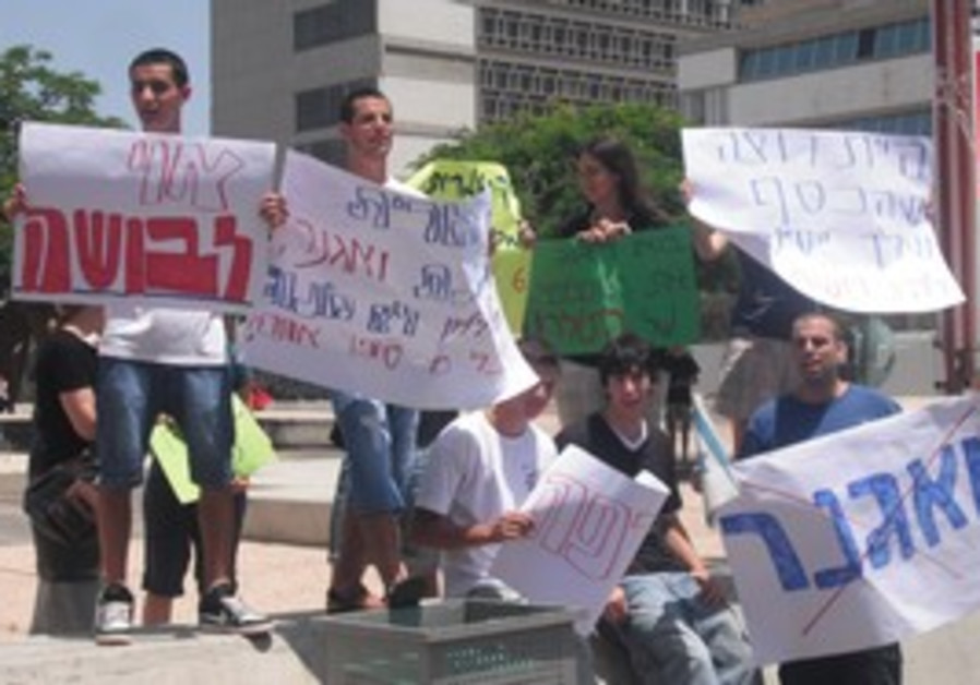 Youths protest outside the Tel Aviv Museum, Tues.