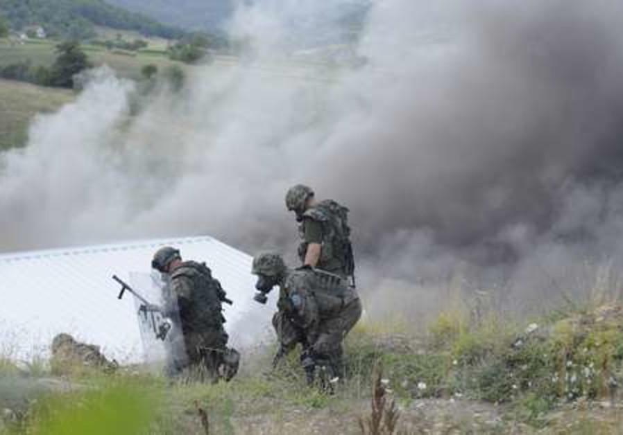 KFOR soldiers patrol Serbia-Kosovo border