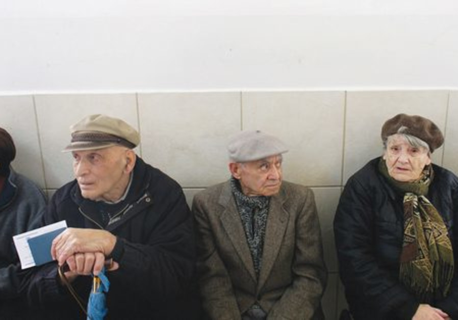 Elderly Israelis wait to vote at a polling station
