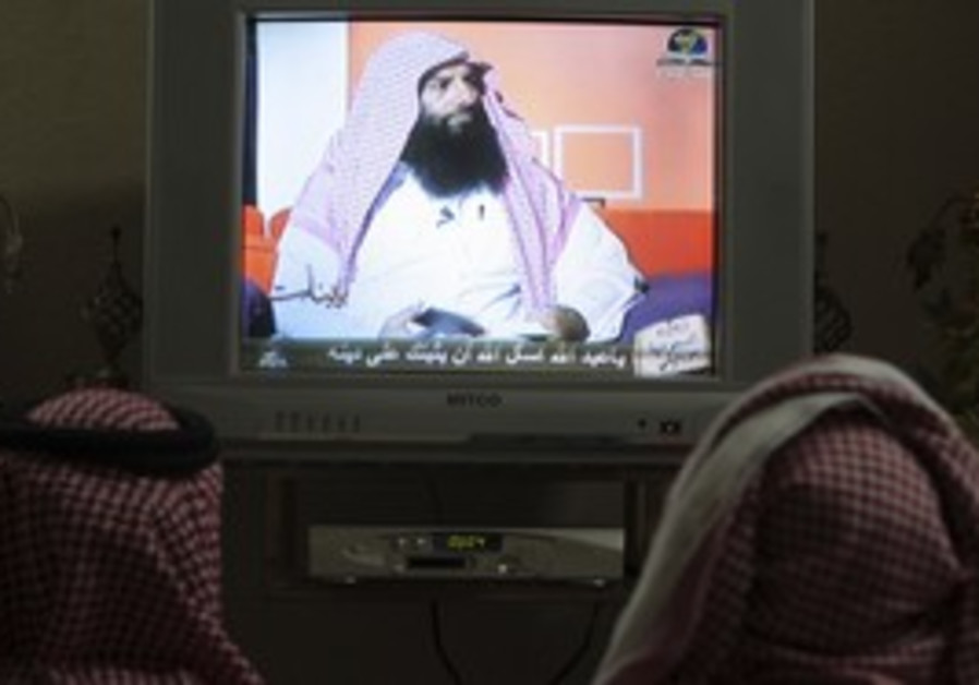 Saudis watching Ramadan television program