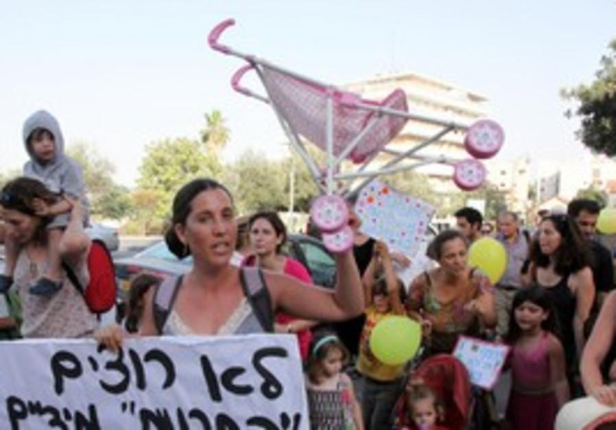 Parents take part in Jerusalem's 'stroller march'.