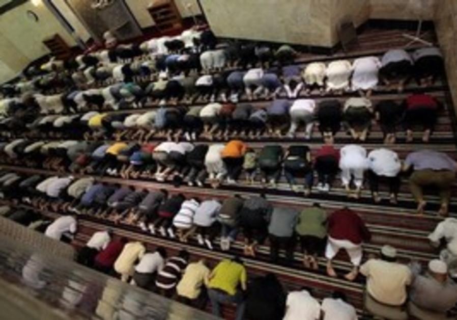 Muslims pray during Ramadan