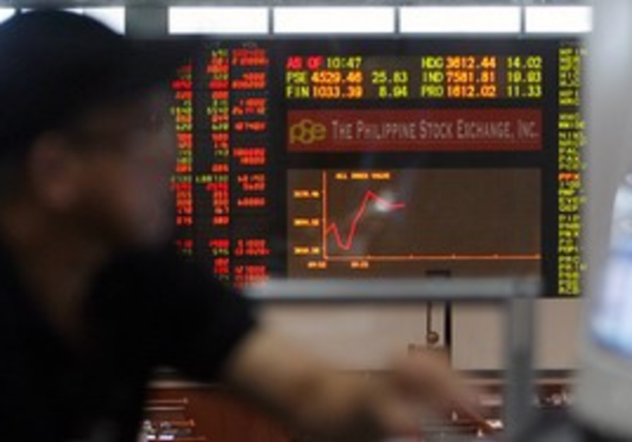 Stock trader monitors market movement
