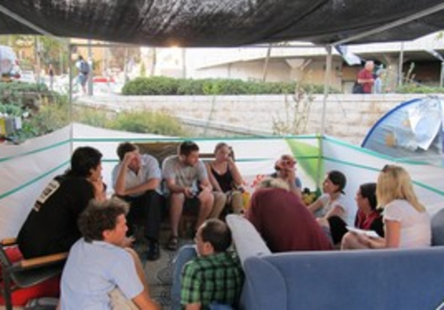 PROTESTERS HANG OUT in the capital's Kikar Paris.