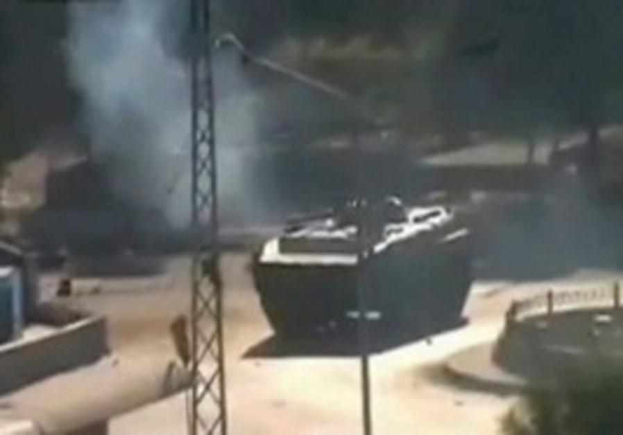 Syrian tank moves through city (illustrative)