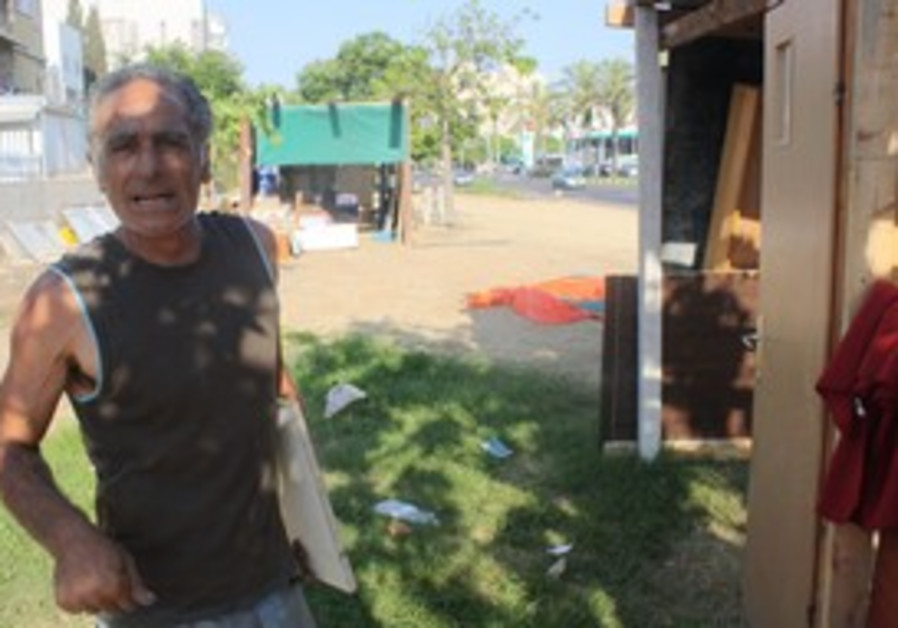Moshe Dabush at tent city in Holon slum