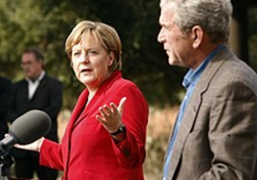 Bush, Merkel say they'll continue diplomacy on Iran