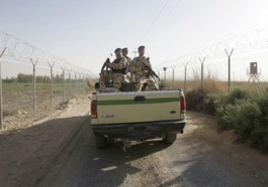 Iraqi soldiers patrol the Iraqi-Syrian border