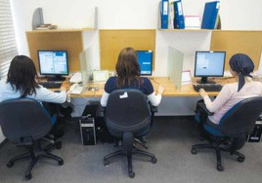 Orthodox women sitting at computers.
