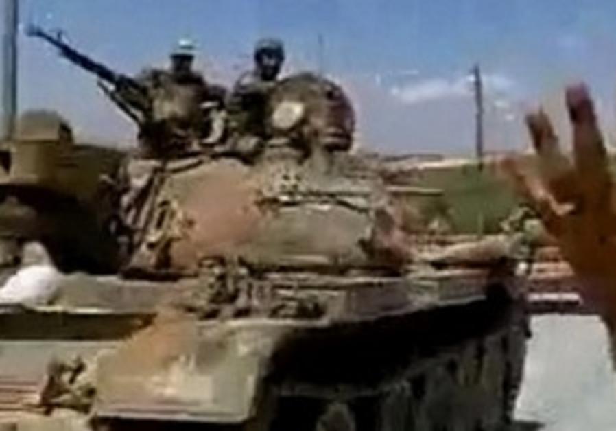 Syrian soldiers man tank (illustrative)