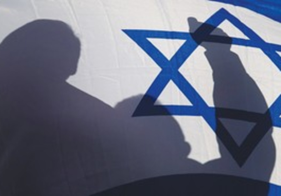 Supporter waves flag at pro-Israel rally in Hondur