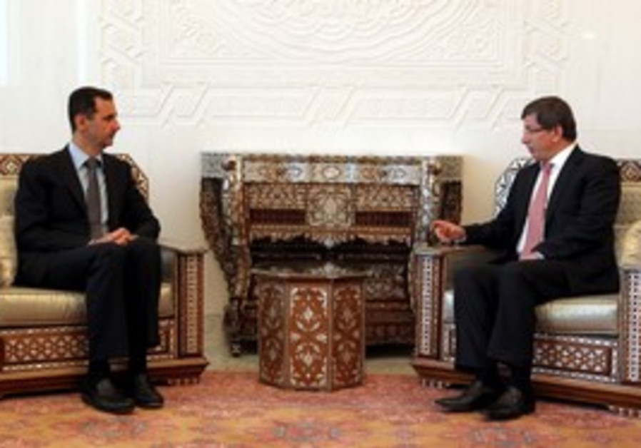 Turkish President Davutoglu with Bashar Assad
