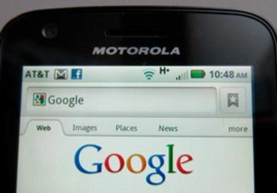 Motorola Droid phone is seen displaying Google