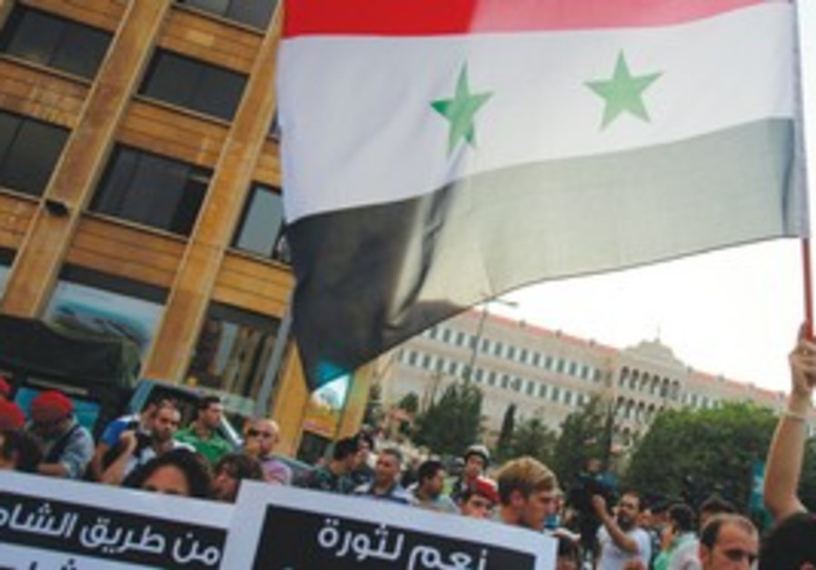 Activists rally against Syria violence in Beirut