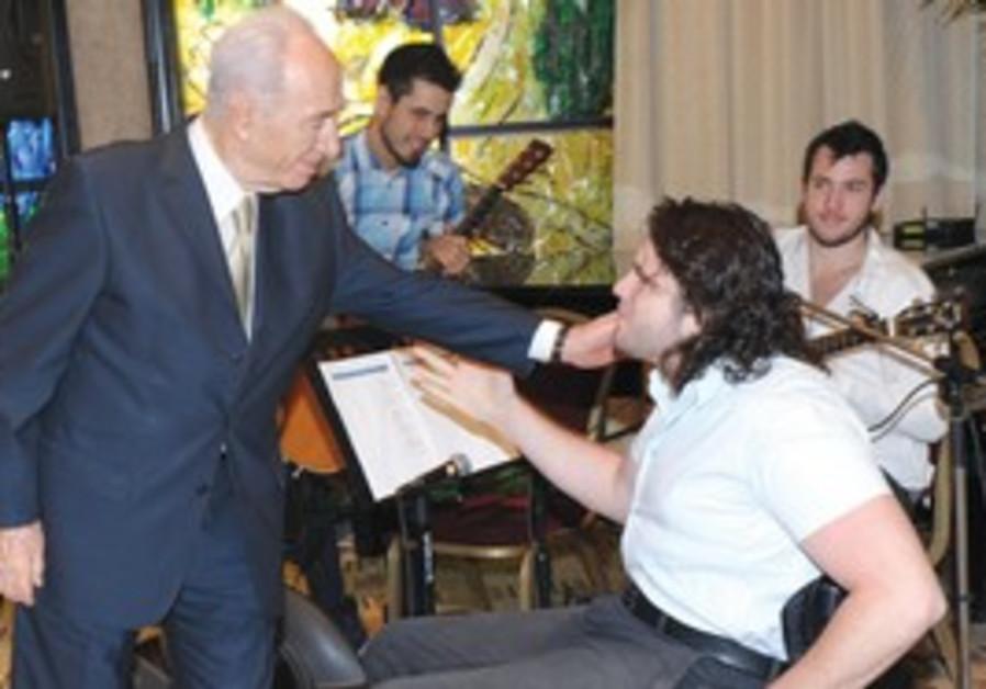 President Peres and wheelchair basketball team