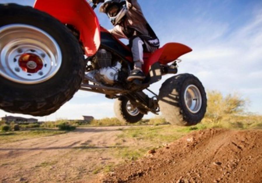 Youth riding ATV [illustrative]