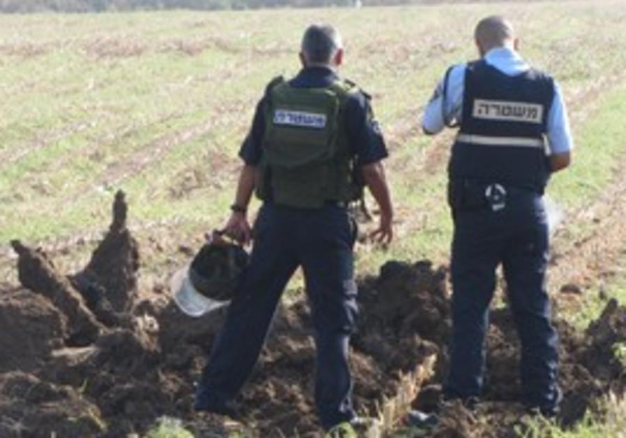 Police survey site of Grad rocket explosio