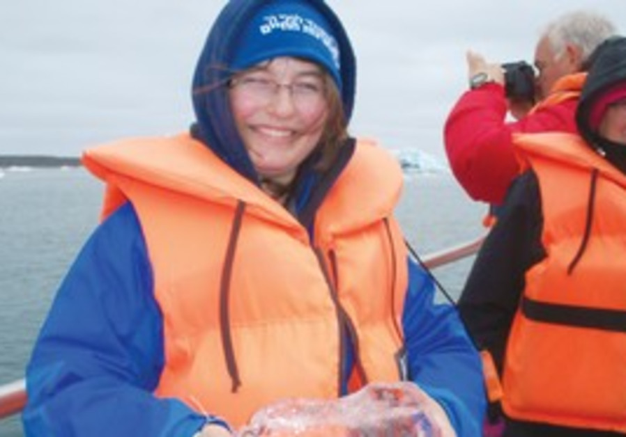 Writer's granddaughter Dvora holds glacier ice.