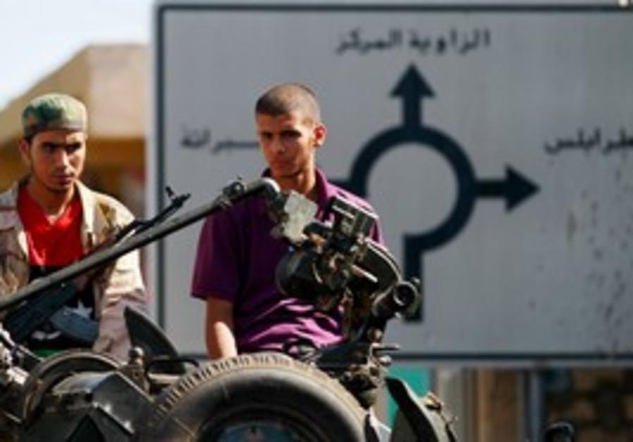 Libyan rebel fighters outside Tripoli