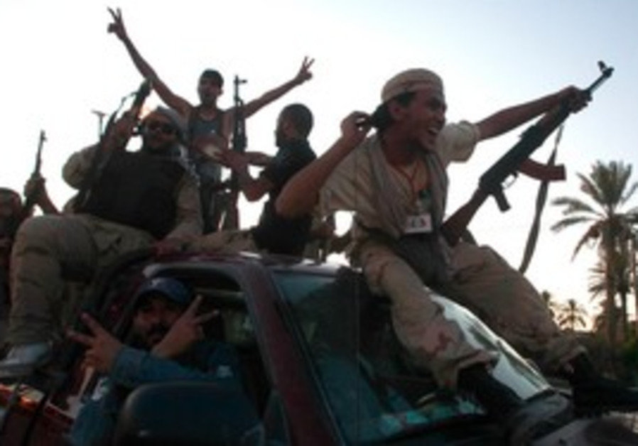 Libyan rebels celebrate on outskirts of Tripoli