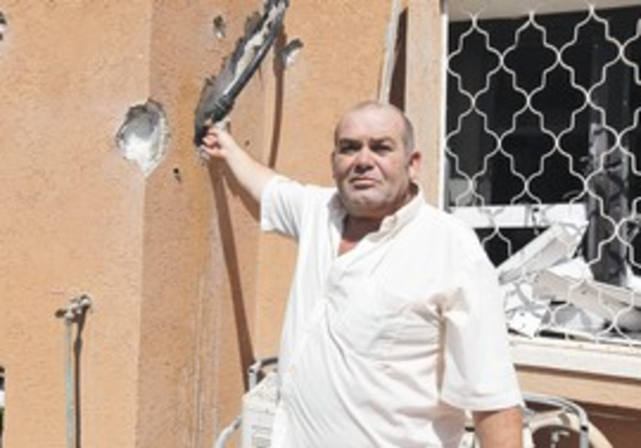 MEIR DIMRI shows the damage to his Beersheba home