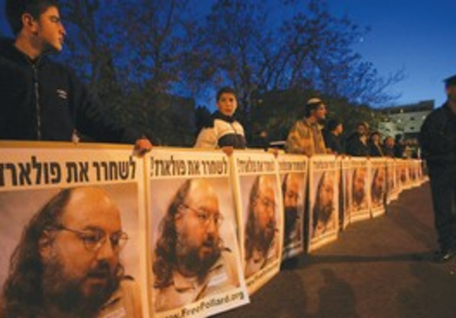 PROTESTERS HOLD posters calling to free Pollard