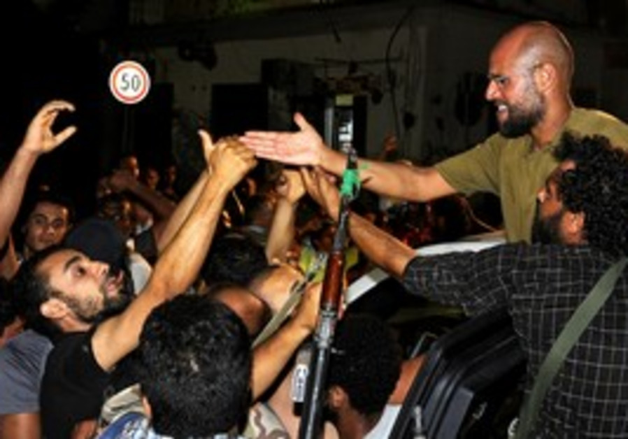 Saif al-Islam Gaddafi with supporters in Tripoli
