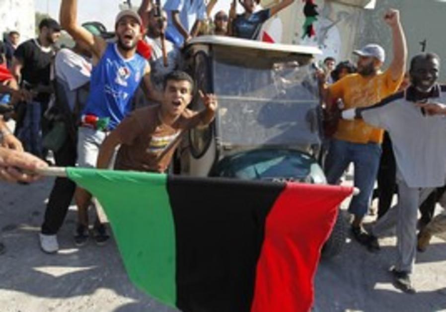 Libyans celebrating the capture Bab al Aziziya