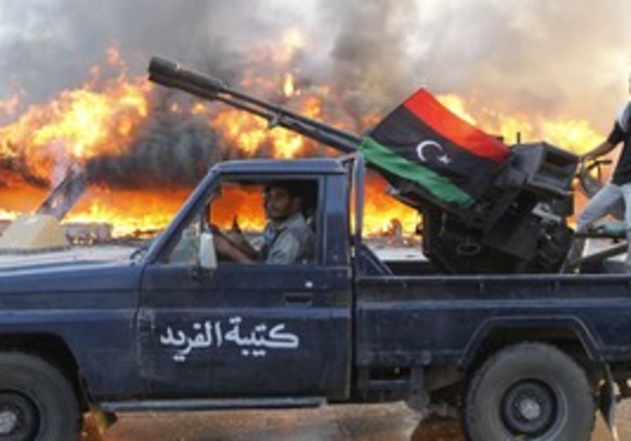 Libyan rebels ride along Bab al-Aziziyah