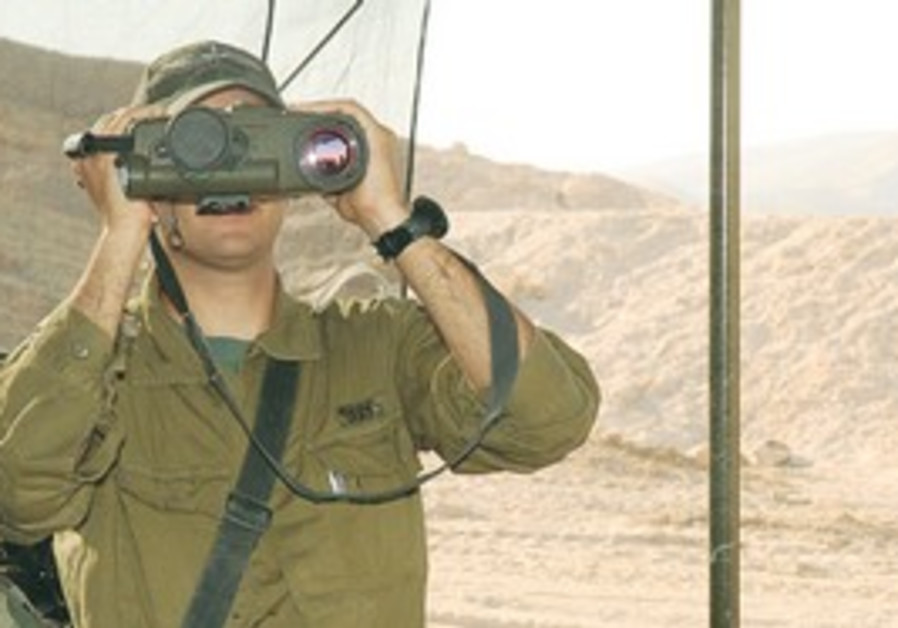 A SOLDIER looks through the Amit targeting system