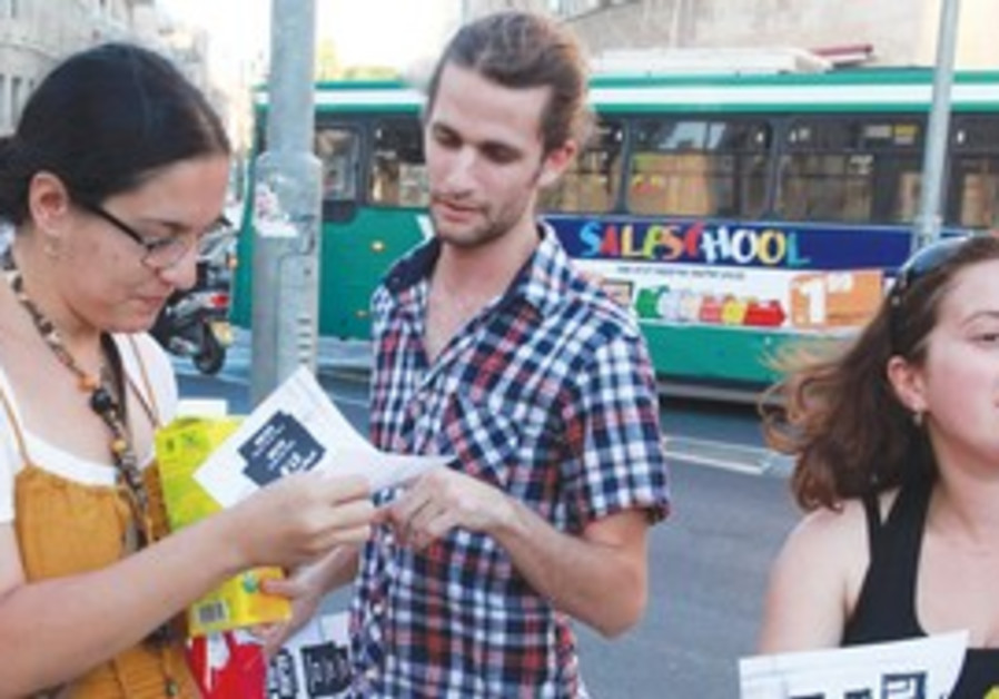 TENT CITY protesters distribute fliers in Jerusale