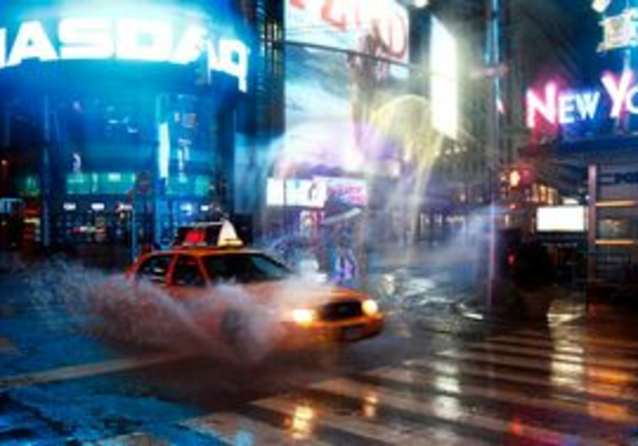 Taxi speeds by on 42nd Street at Times Square