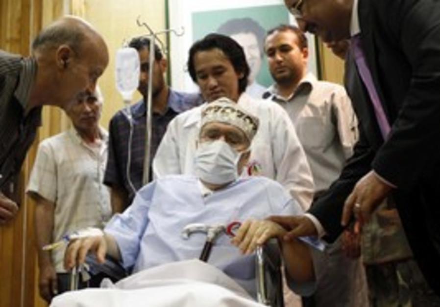 Abdel Basset al-Megrahi sits in a wheelchair