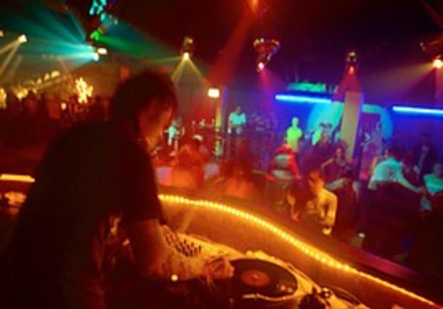 A DJ at a nightclub [illustrative]