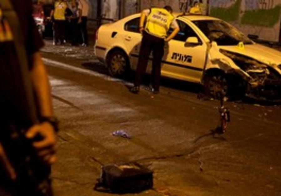 Policemen inspect scene of Tel Aviv terror attack