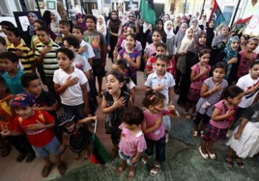 Libyan children sing new national anthem.