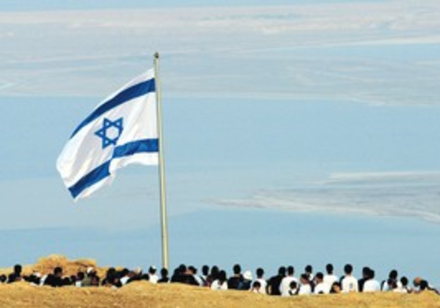 Israeli flag flies at ancient fortress of Masada.