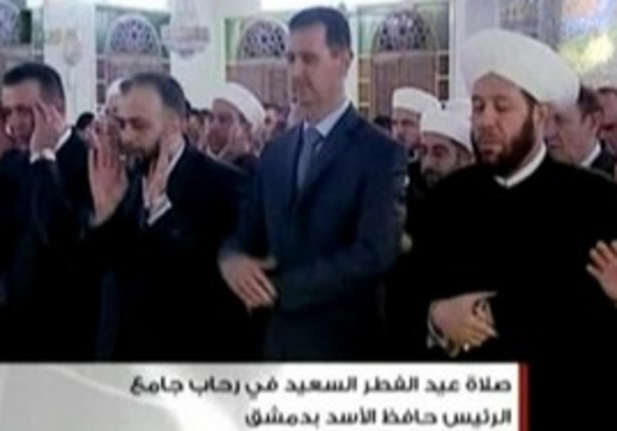 Syrian President Bashar Assad praying