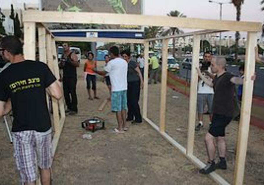 Activists at the Jesse Cohen tent city