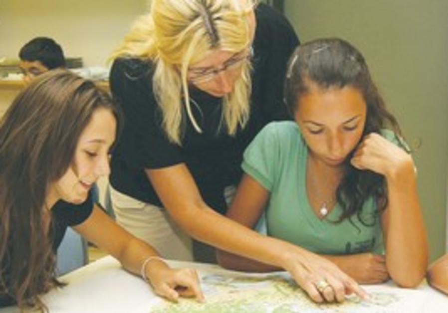 Teacher with students (illustrative)
