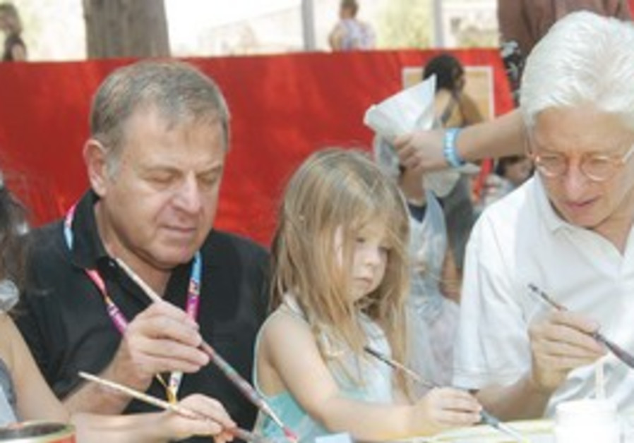 James Snyder and Michael Dayan paint with children