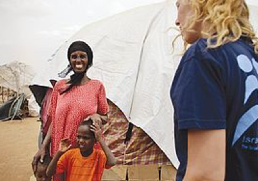 AN ISRAELI aid worker speaks to a Somalian woman i