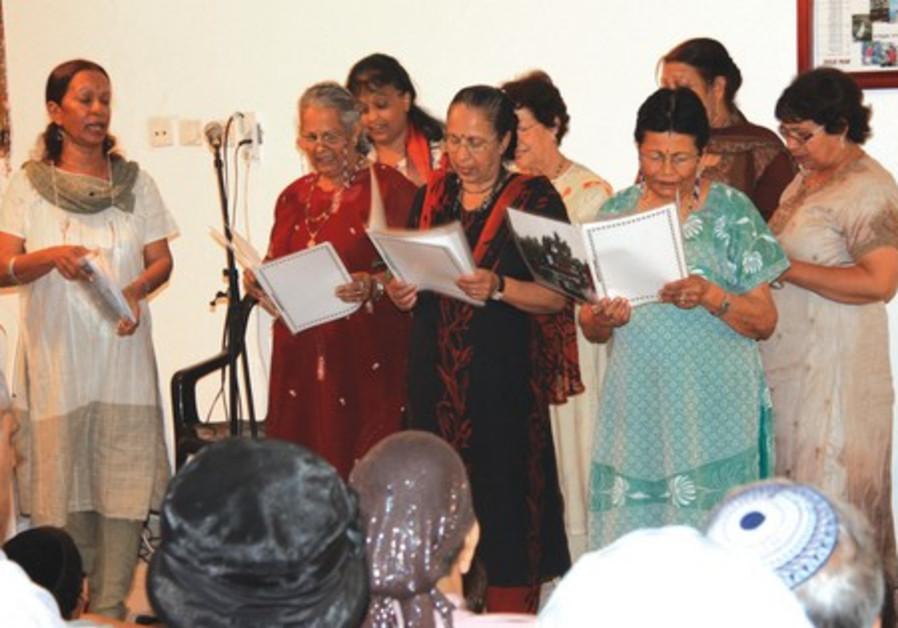Tova Aharon-Kastiel (left) leads chorus