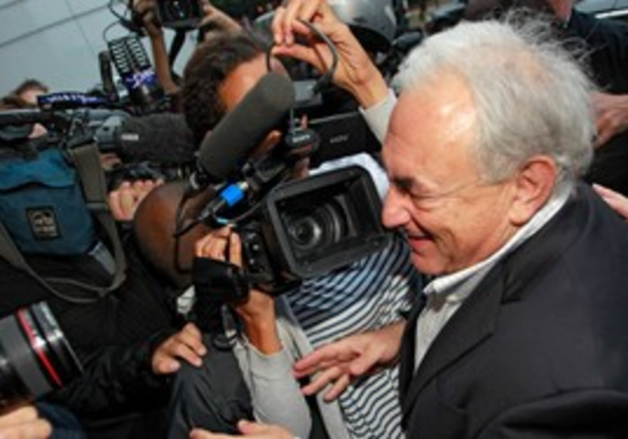 Dominique Strauss-Kahn returns home