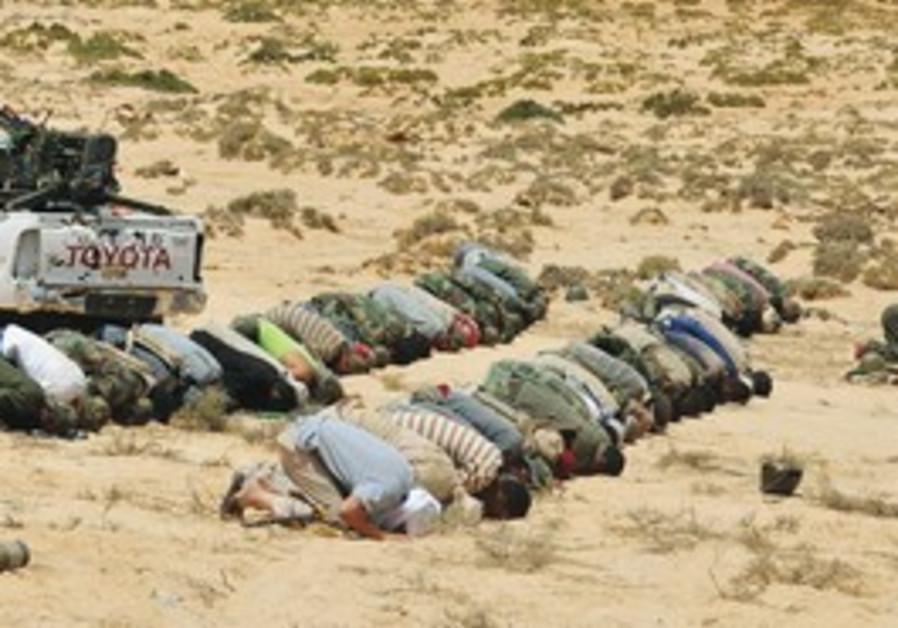 Libyan rebels praying.