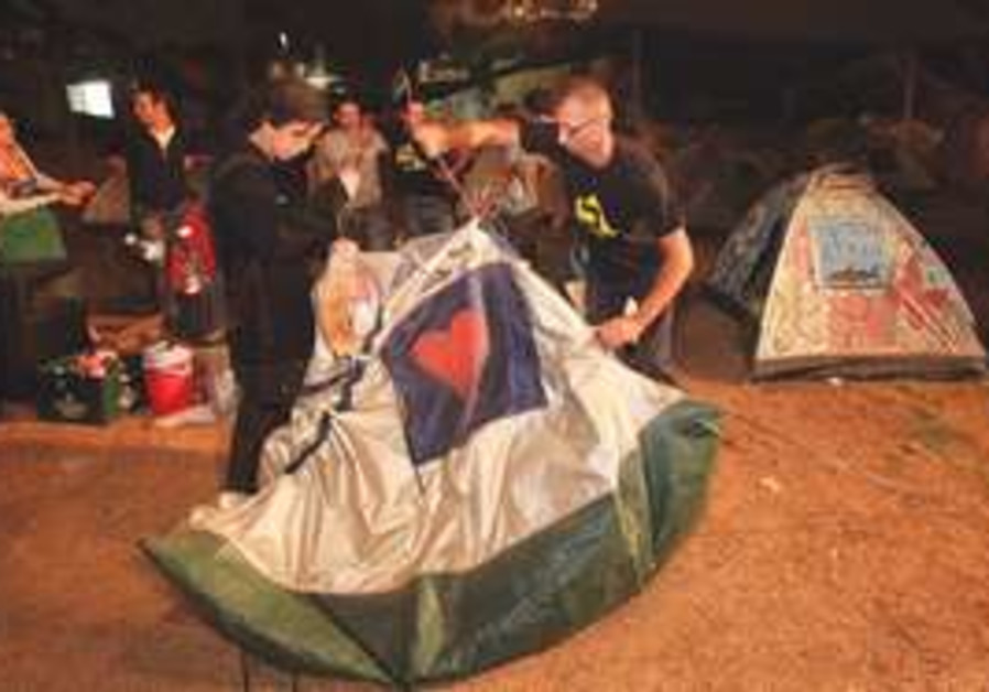 Students dismantle tents