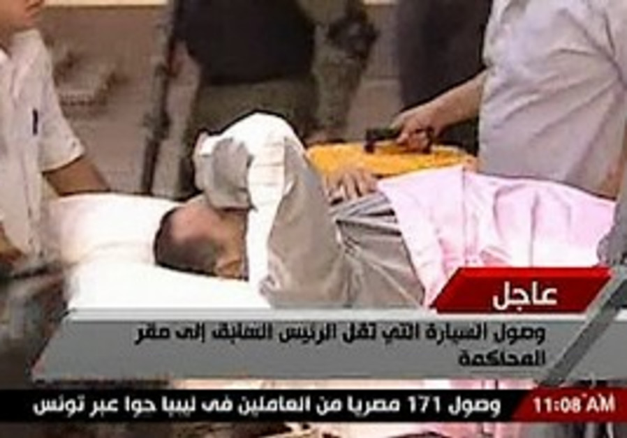 Mubarak is wheeled in to his trial